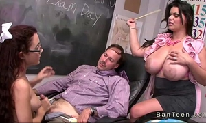 Teen with glasses gives tugjob in three-some
